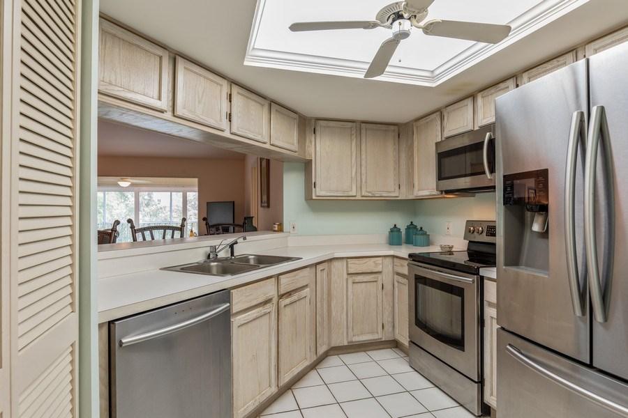 Real Estate Photography - 5895 Chanteclair, Unit 128, Naples, FL, 34108 - Kitchen