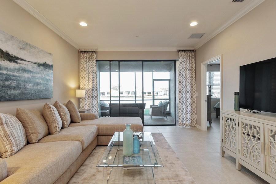Real Estate Photography - 9433 Benvenuto Court, 102, Naples, FL, 34119 - Living Room