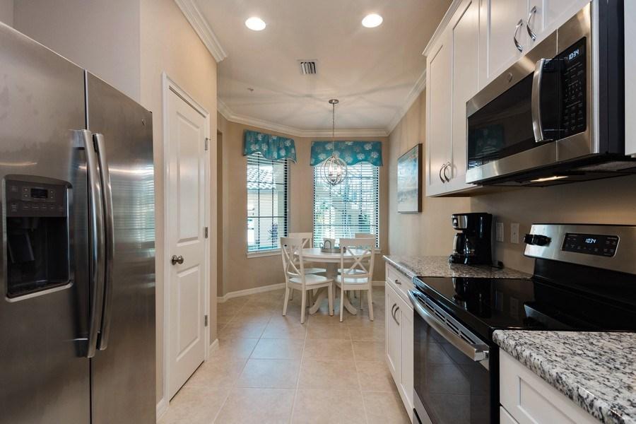 Real Estate Photography - 9433 Benvenuto Court, 102, Naples, FL, 34119 - Kitchen