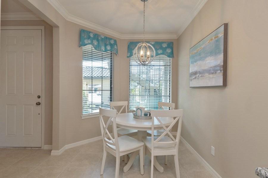 Real Estate Photography - 9433 Benvenuto Court, 102, Naples, FL, 34119 - Breakfast room