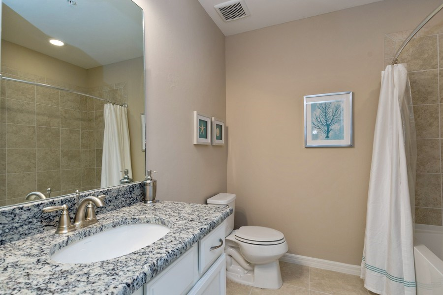 Real Estate Photography - 9433 Benvenuto Court, 102, Naples, FL, 34119 - Guest Bath