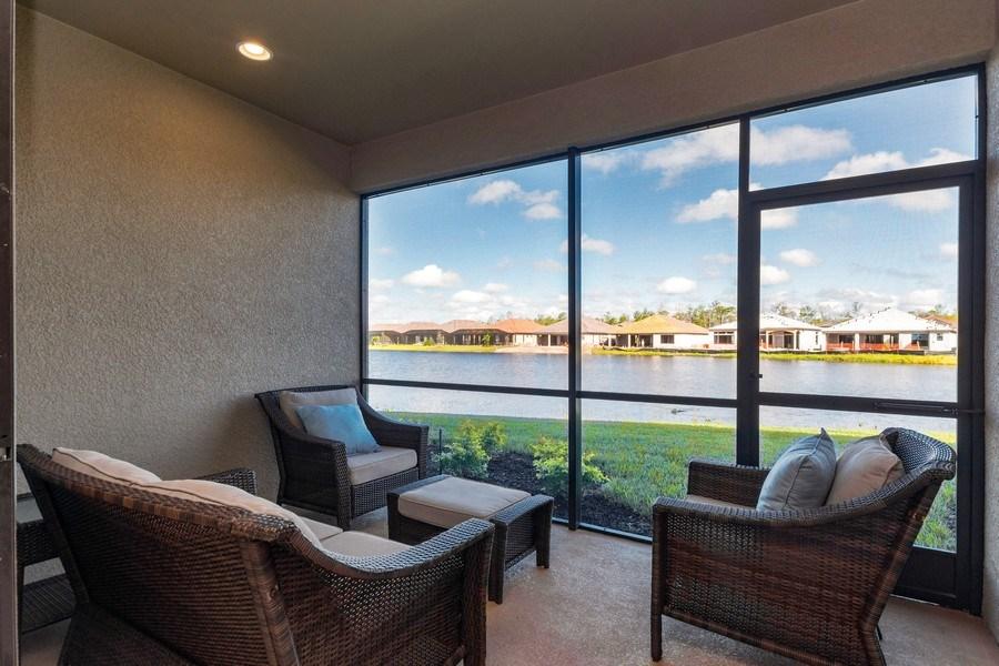 Real Estate Photography - 9433 Benvenuto Court, 102, Naples, FL, 34119 - Screened Lanai