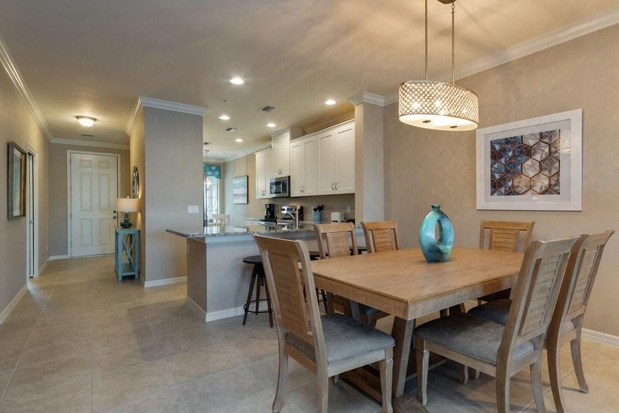 Real Estate Photography - 9433 Benvenuto Court, 102, Naples, FL, 34119 - Dining Room