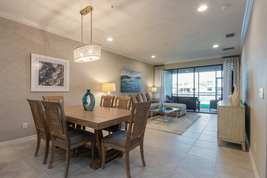Real Estate Photography - 9433 Benvenuto Court, 102, Naples, FL, 34119 - Living Room / Dining Room
