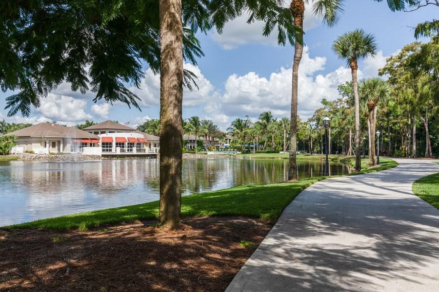 Real Estate Photography - 767 Glendevon Drive, Naples, FL, 34105 - Short path to Club & Pool