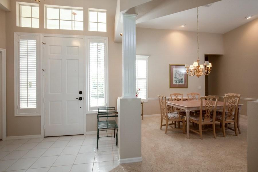 Real Estate Photography - 767 Glendevon Drive, Naples, FL, 34105 - Foyer/Dining Room