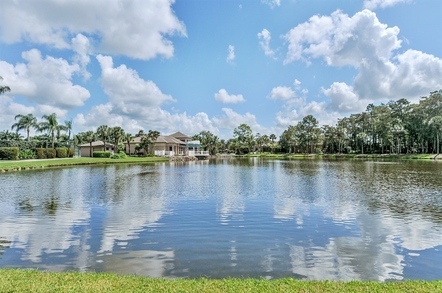 Real Estate Photography - 767 Glendevon Drive, Naples, FL, 34105 - Lake view from 767
