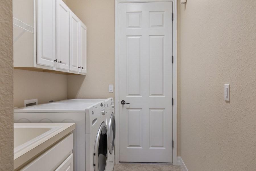 Real Estate Photography - 20982 TORRE DEL LAGO ST, ESTERO, FL, 33928 - Laundry Room