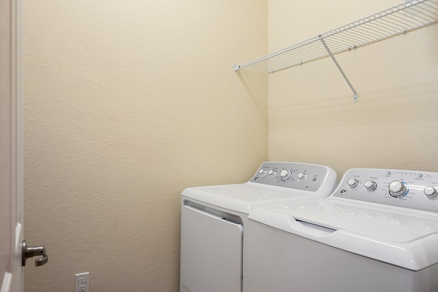 Real Estate Photography - 28030 Cookstown Ct, 2903, Bonita Springs, FL, 34135 - Laundry Room