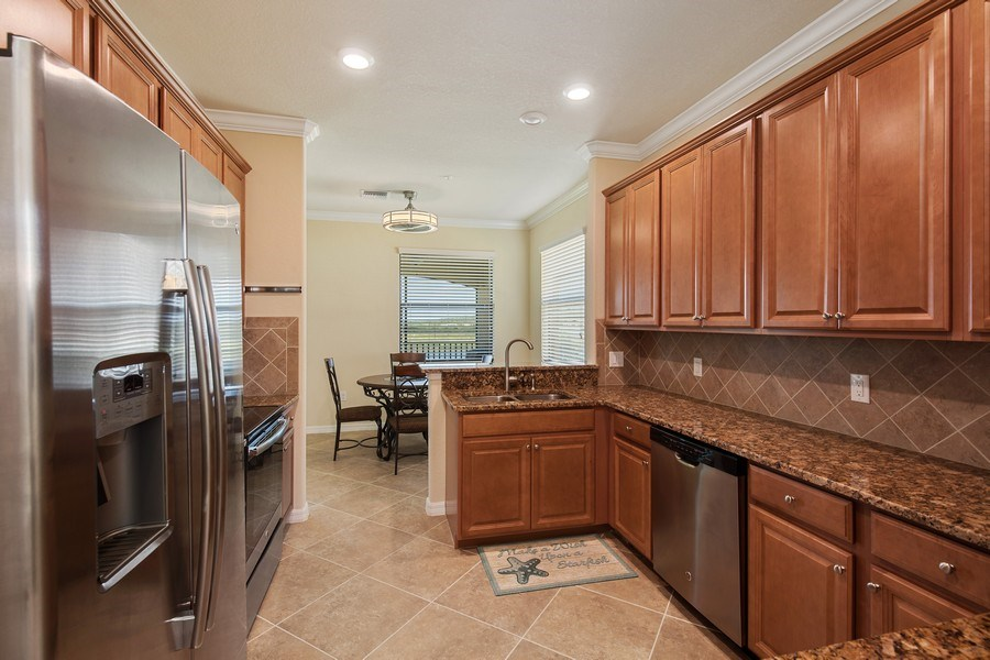 Real Estate Photography - 28030 Cookstown Ct, 2903, Bonita Springs, FL, 34135 - Kitchen