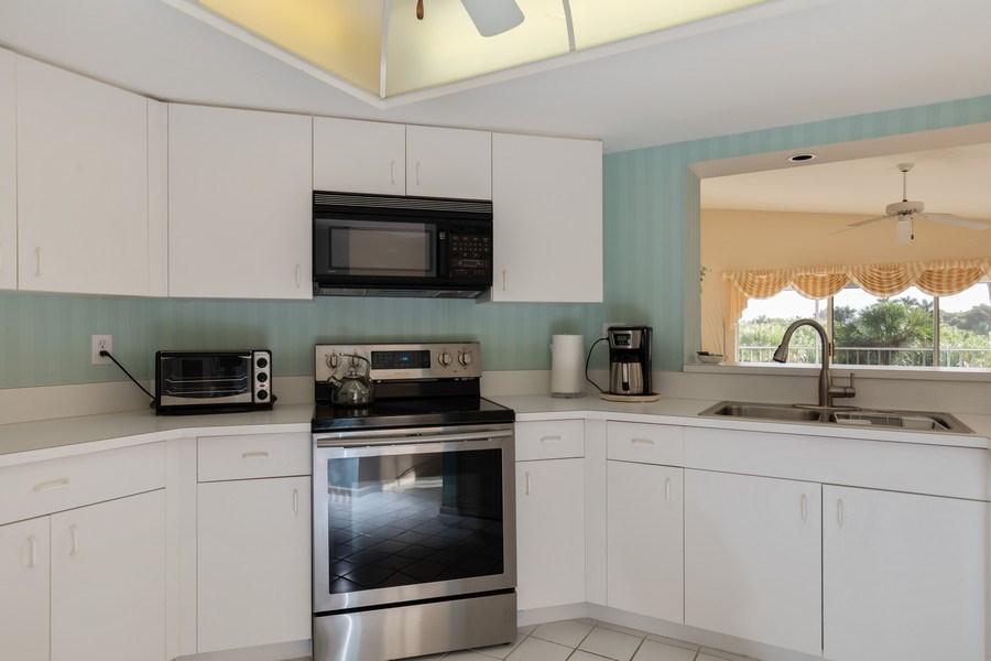 Real Estate Photography - 4200 Lake Forest Dr, 1622, Bonita Springs, FL, 34134 - Kitchen