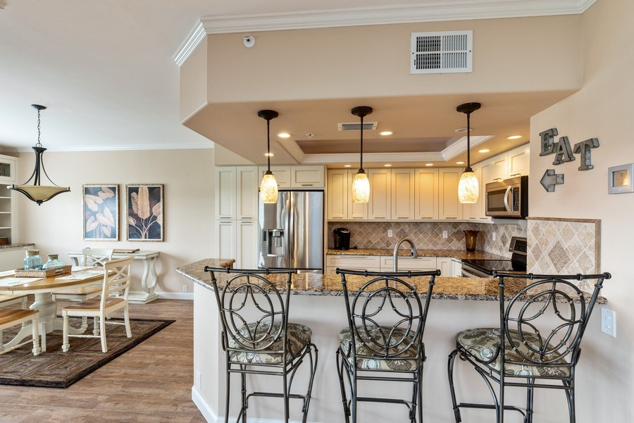 Real Estate Photography - 28012 Cavendish Ct. #5001, Bonita Springs, FL, 34135 - Kitchen / Dining Room