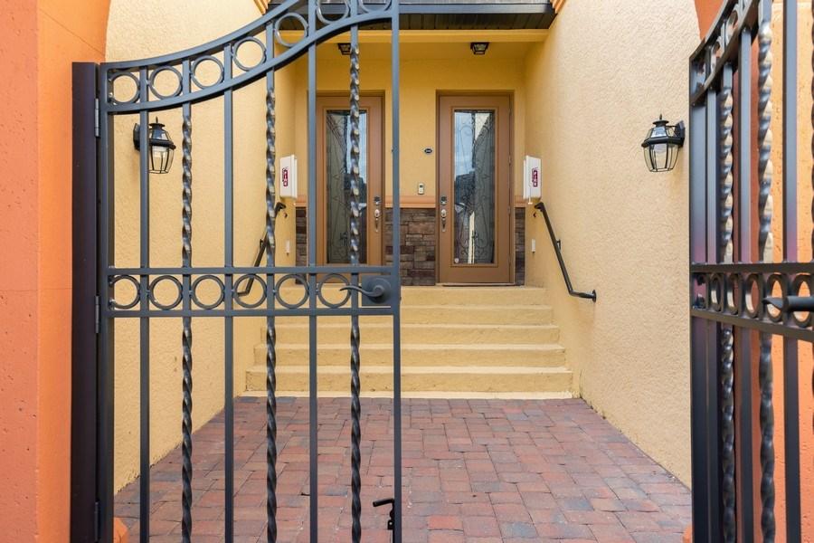 Real Estate Photography - 28010 Cookstown Ct, 3103, Bonita Springs, FL, 34135 - Front View
