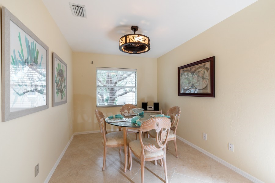 Real Estate Photography - 132 Pebble Shores Drive #201, Naples, FL, 34110 - Dining Room