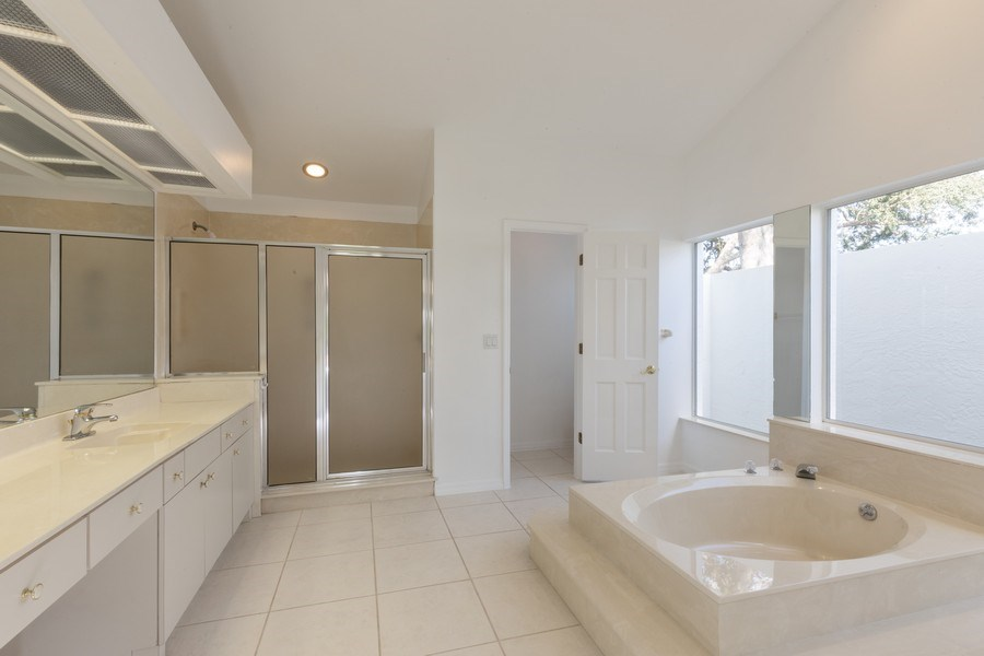 Real Estate Photography - 1918 Imperial Golf Course Blvd., Naples, FL, 34110 - Master Bathroom