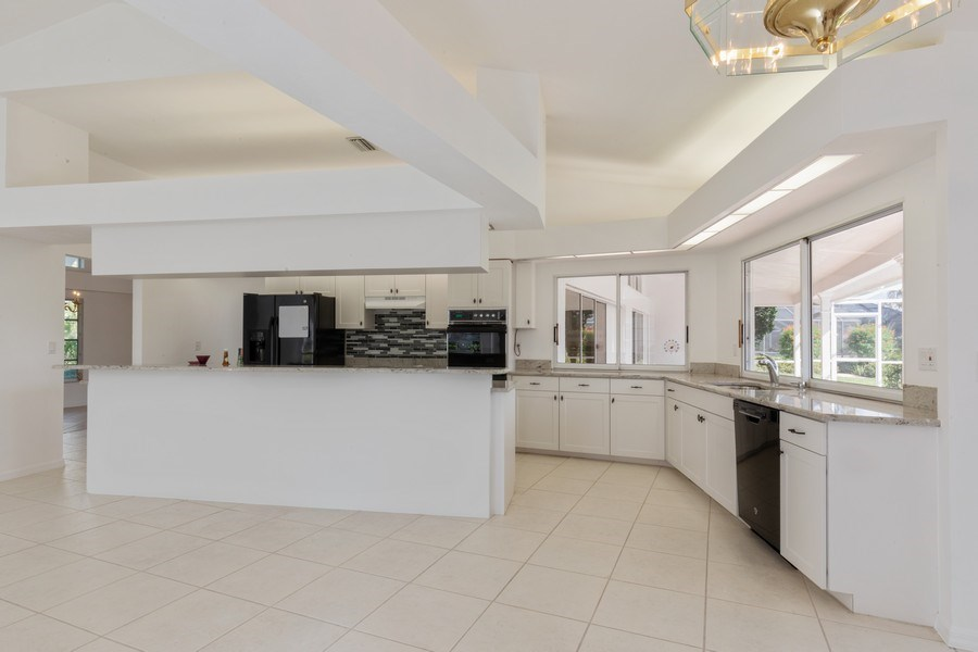 Real Estate Photography - 1918 Imperial Golf Course Blvd., Naples, FL, 34110 - Kitchen