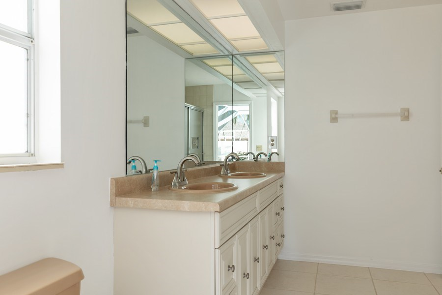 Real Estate Photography - 1918 Imperial Golf Course Blvd., Naples, FL, 34110 - 2nd Bathroom