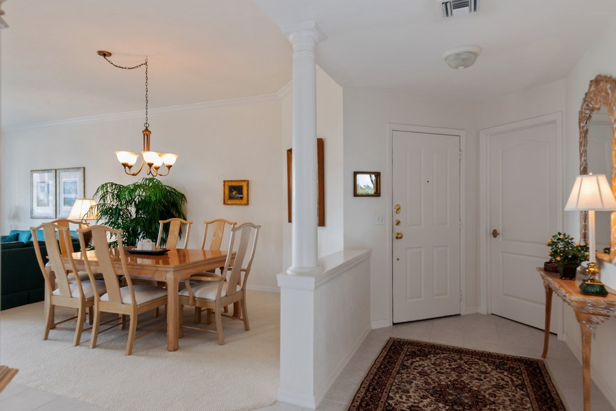 Real Estate Photography - 7008 Pelican Bay Blvd, Unit H305, Naples, FL, 34108 - Foyer/Dining Room