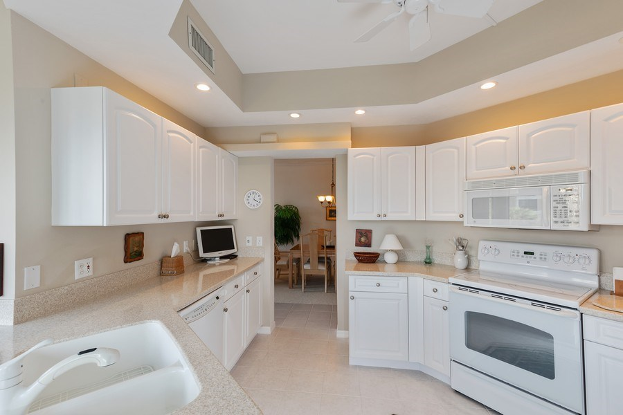 Real Estate Photography - 7008 Pelican Bay Blvd, Unit H305, Naples, FL, 34108 - Kitchen