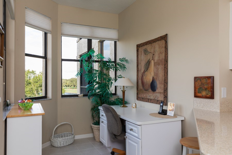 Real Estate Photography - 7008 Pelican Bay Blvd, Unit H305, Naples, FL, 34108 - Kitchen Desk
