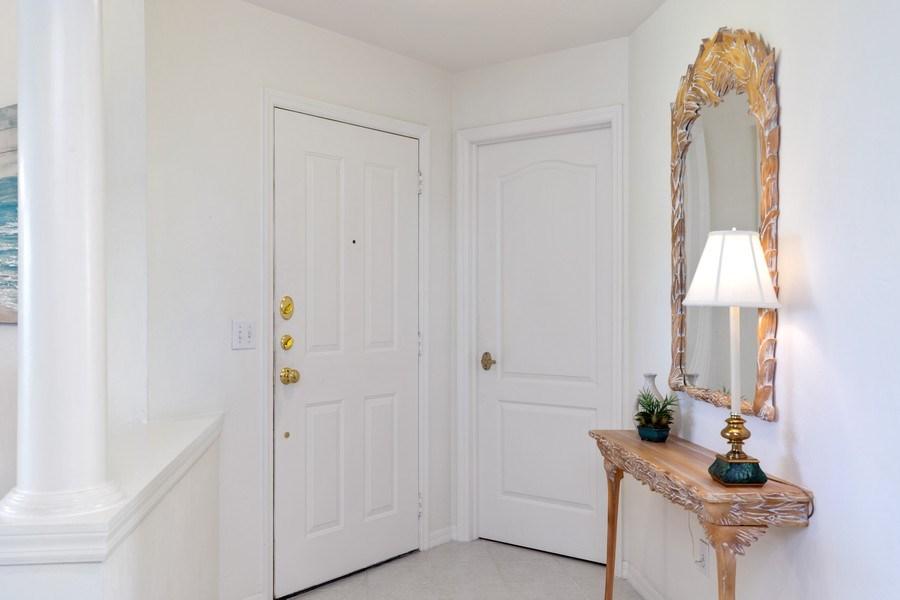 Real Estate Photography - 7008 Pelican Bay Blvd, Unit H305, Naples, FL, 34108 - Foyer