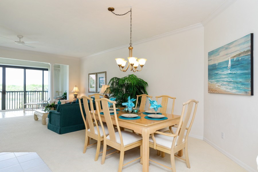 Real Estate Photography - 7008 Pelican Bay Blvd, Unit H305, Naples, FL, 34108 - Dining Area