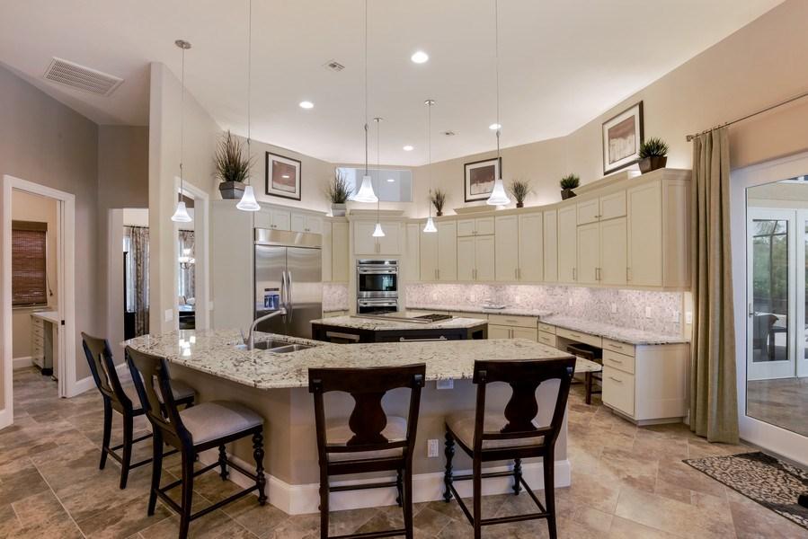 Real Estate Photography - 25011 Pennyroyal Dr, Bonita Springs, FL, 34134 - Kitchen