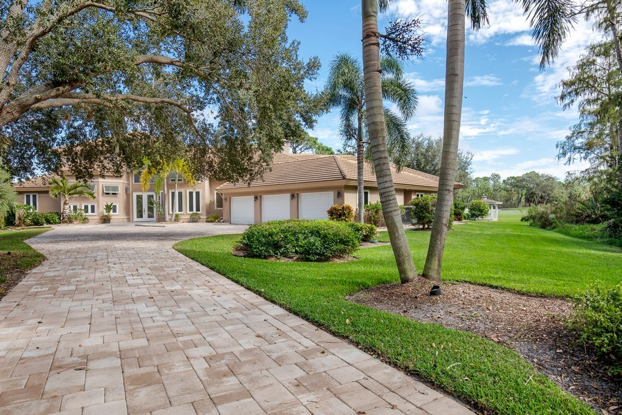 Real Estate Photography - 25011 Pennyroyal Dr, Bonita Springs, FL, 34134 - Driveway