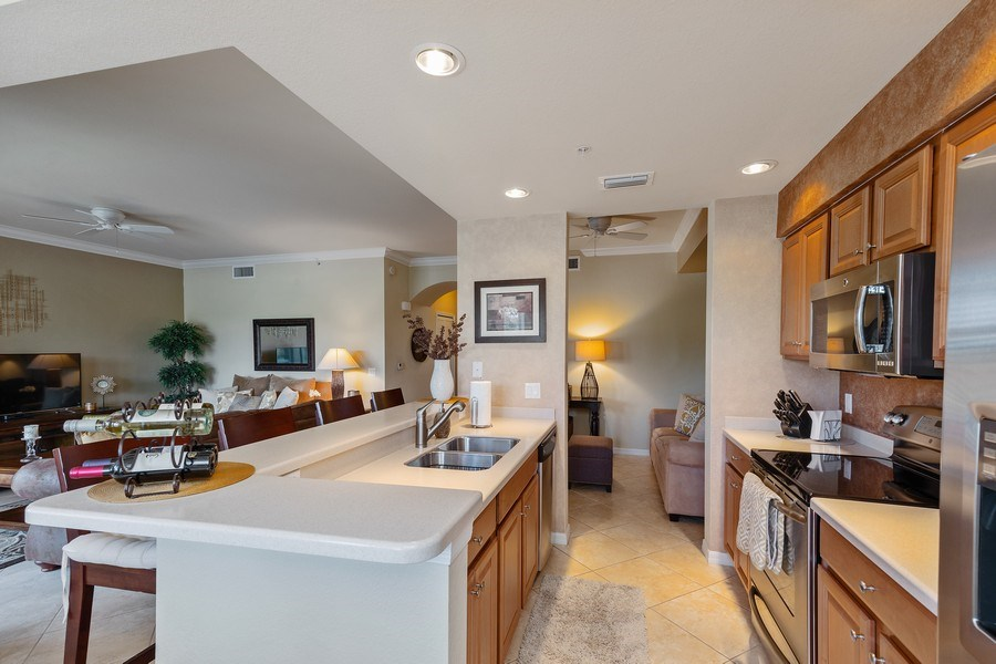 Real Estate Photography - 10317 Heritage Bay Blvd, Unit 1427, Naples, FL, 34120 - Kitchen