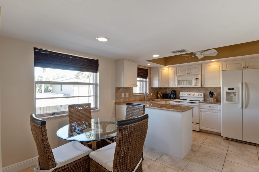 Real Estate Photography - 3200 Binnacle Drive, F3, Naples, FL, 34103 - Kitchen / Dining Room