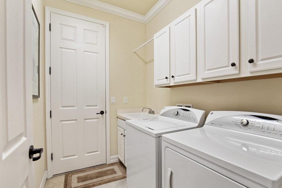 Real Estate Photography - 28549 Westmeath Ct, Bonita Springs, FL, 34135 - Laundry Room