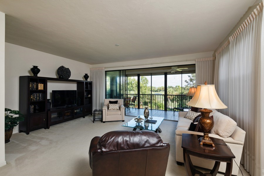 Real Estate Photography - 7008 Pelican Bay Blvd, H204, Naples, FL, 34108 - Living Room