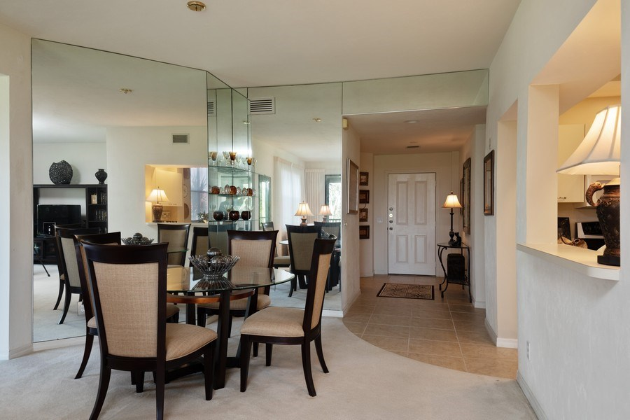 Real Estate Photography - 7008 Pelican Bay Blvd, H204, Naples, FL, 34108 - Foyer/Dining Room