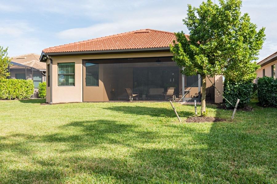Real Estate Photography - 28556 San Amaro, Naples, FL, 34103 - Rear View