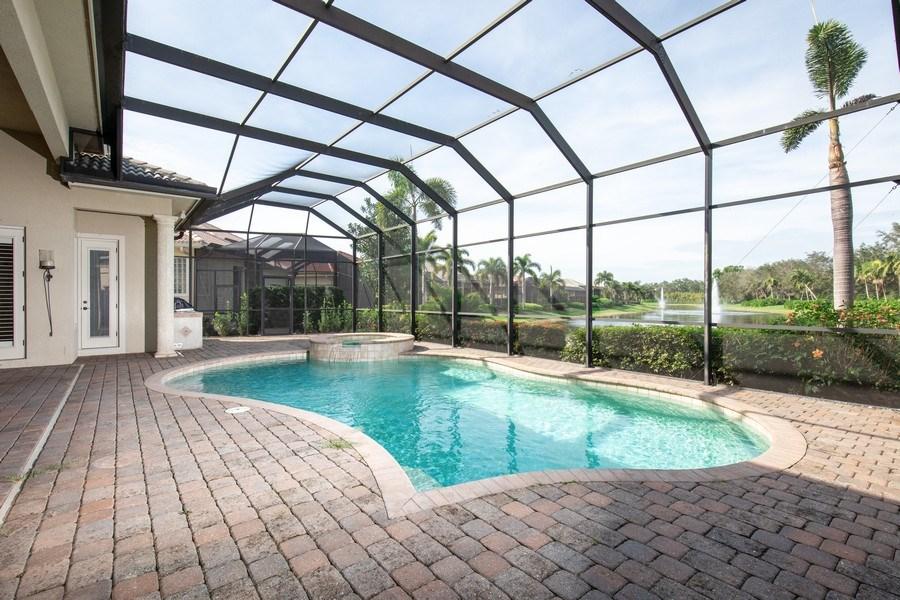 Real Estate Photography - 5799 Hammock Isles Dr, Naples, FL, 34119 - Pool