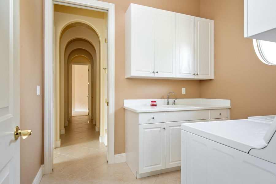 Real Estate Photography - 5799 Hammock Isles Dr, Naples, FL, 34119 - Laundry Room