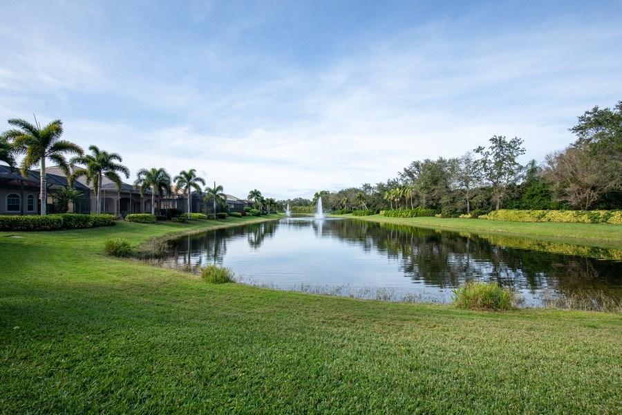 Real Estate Photography - 5799 Hammock Isles Dr, Naples, FL, 34119 - Lake View