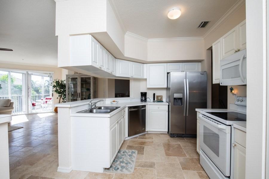 Real Estate Photography - 9060 Palmas Grandes Blvd. #201, Bonita Springs, FL, 34135 - Kitchen