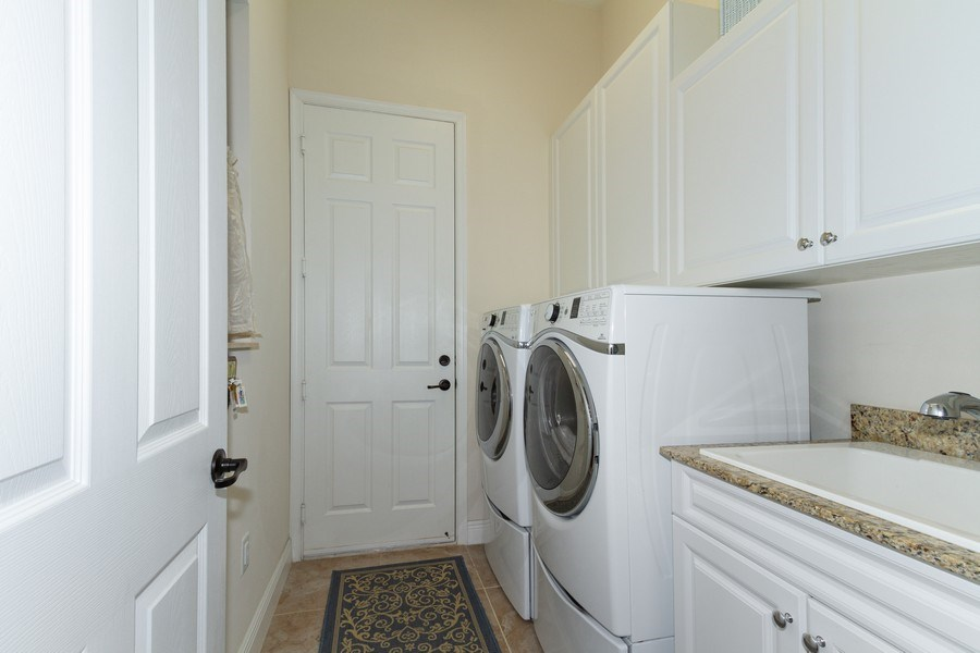 Real Estate Photography - 5055 Milano Street, Ave Maria, FL, 34142 - Laundry Room