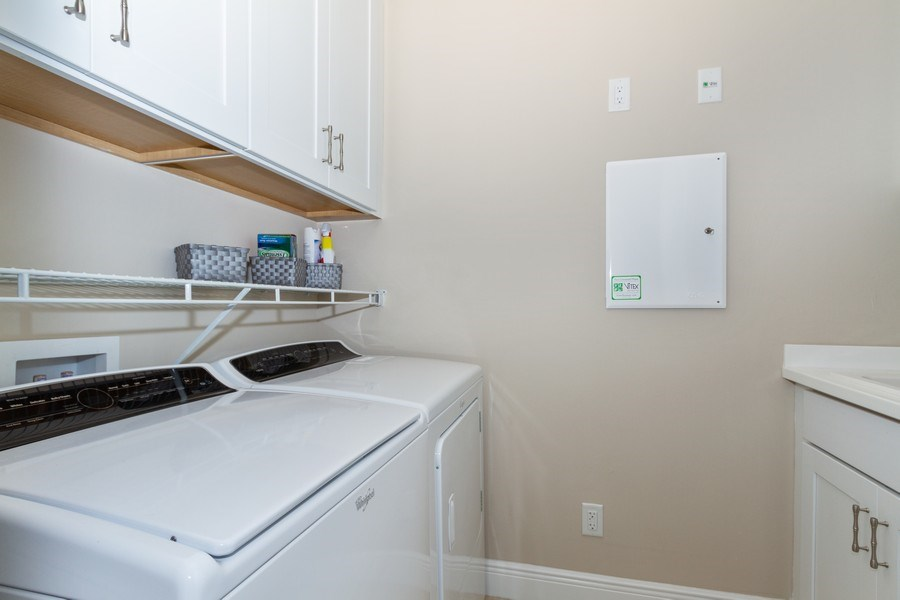 Real Estate Photography - 4456 Tamarind way, Naples, FL, 34119 - Laundry Room