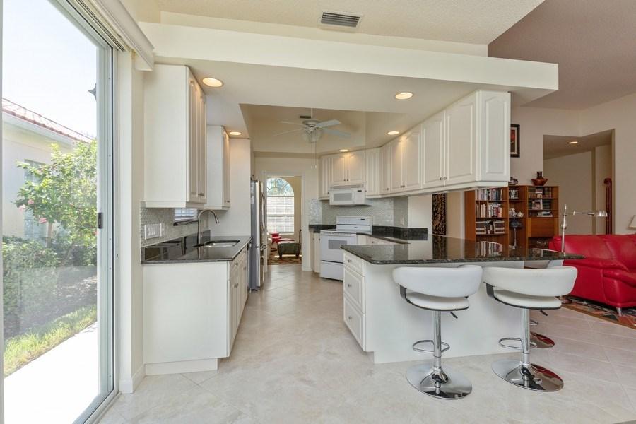 Real Estate Photography - 3411 Donoso Court, Naples, FL, 34109 - Kitchen