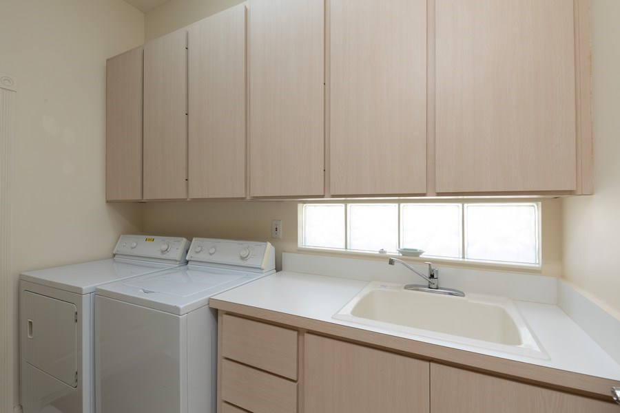 Real Estate Photography - 3411 Donoso Court, Naples, FL, 34109 - Laundry Room