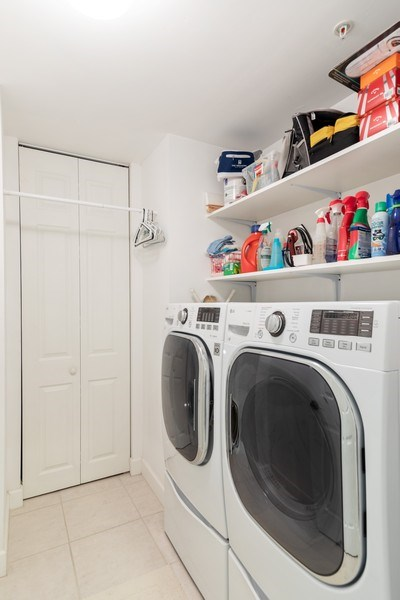 Real Estate Photography - 300 Wyndemere Way302, Naples, FL, 34105 - Laundry Room