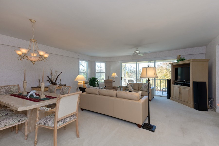 Real Estate Photography - 300 Wyndemere Way302, Naples, FL, 34105 - Living Room/Dining Room