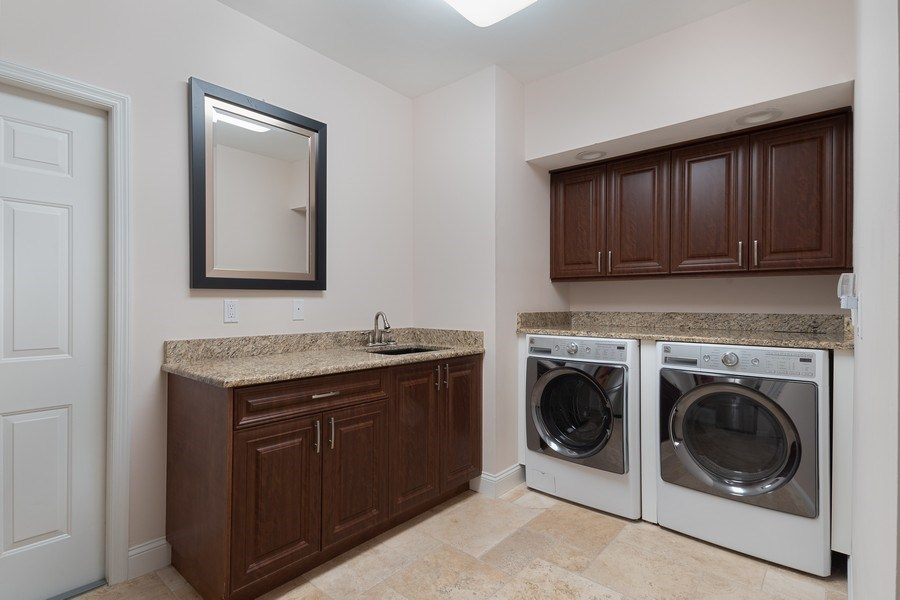 Real Estate Photography - 2016 Imperial Golf Course Blvd, Naples, FL, 34110 - Laundry Room