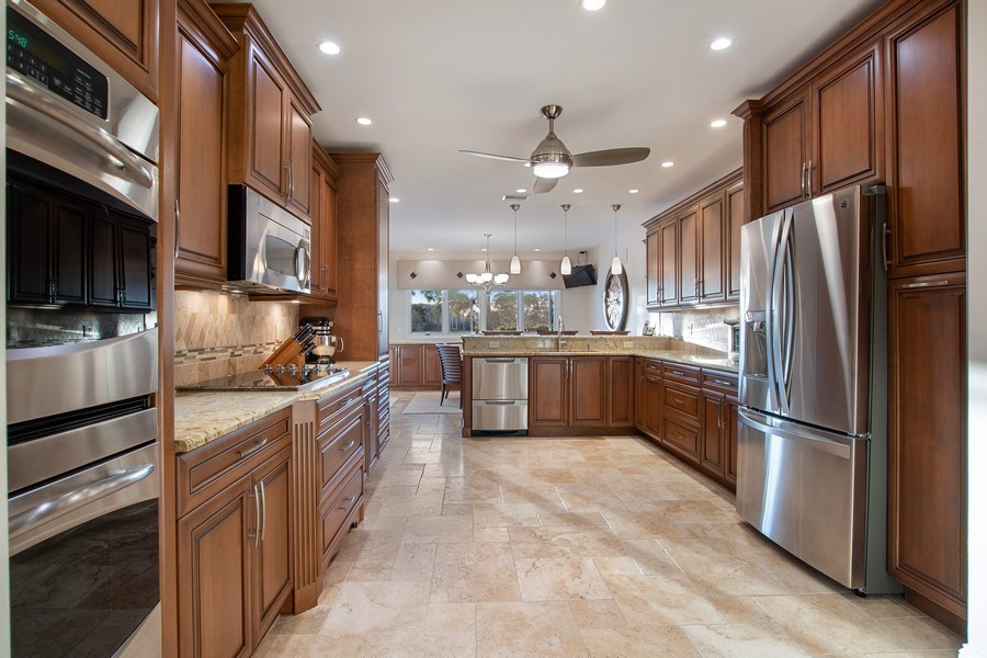 Real Estate Photography - 2016 Imperial Golf Course Blvd, Naples, FL, 34110 - Kitchen