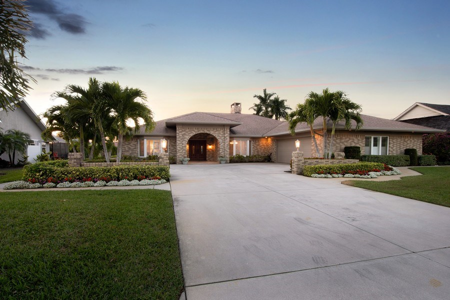 Real Estate Photography - 2016 Imperial Golf Course Blvd, Naples, FL, 34110 - Front View