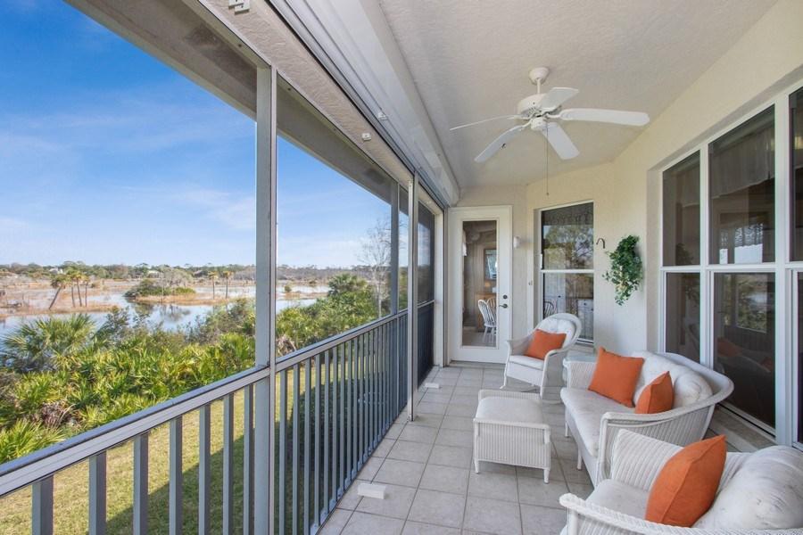 Real Estate Photography - 24360 Sandpiper Isle Way, 202, Bonita Springs, FL, 34134 - Lanai