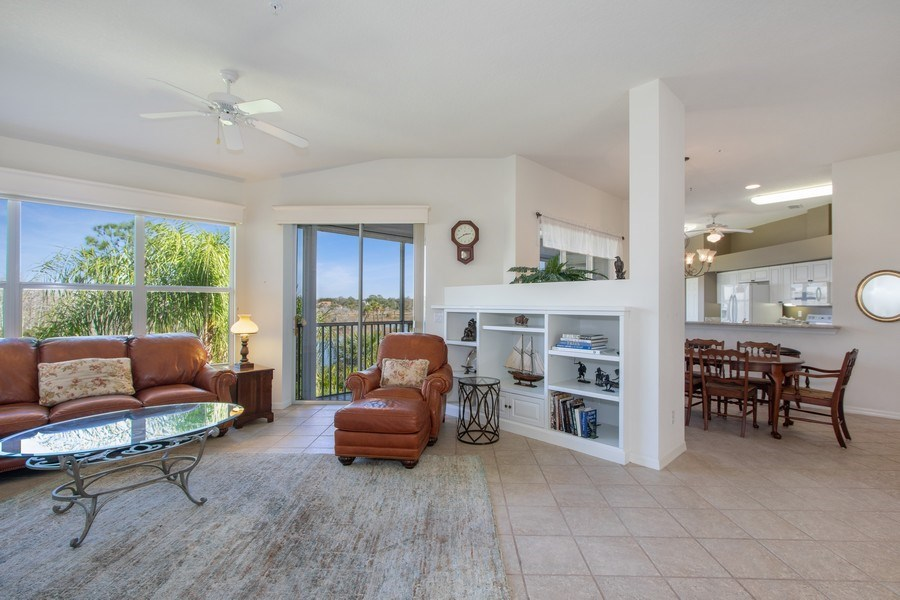 Real Estate Photography - 24360 Sandpiper Isle Way, 202, Bonita Springs, FL, 34134 - Living Room / Dining Room