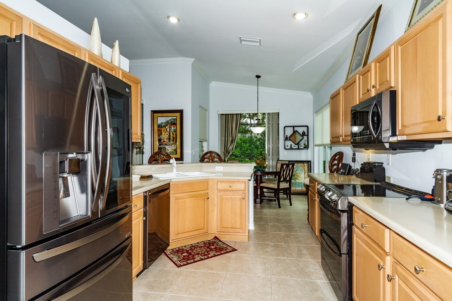 Real Estate Photography - 8848 Ventura Way, Naples, FL, 34109 - Kitchen